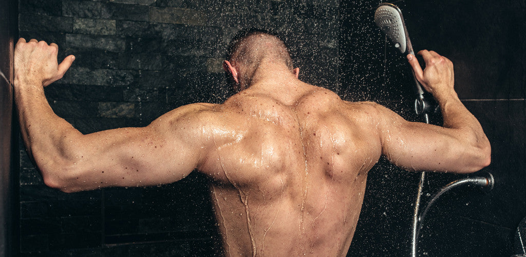 muscly guy takes shower