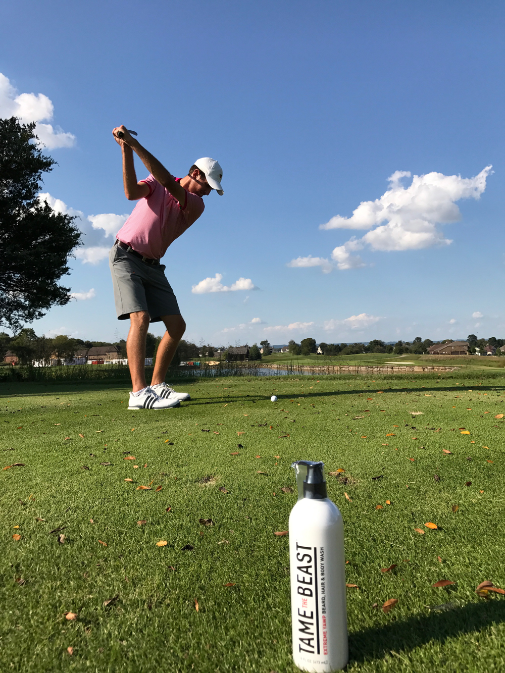Steven Fox Golf Backswing with Tame the Beast Bottle serving as caddie