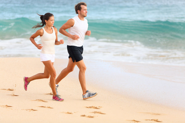 couple wearing light colored clothing while exercising in summer