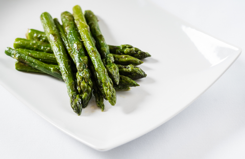 roasted asparagus on white plate