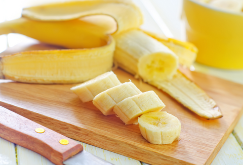 sliced bananas on wooden cutting board