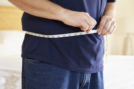 big belly with measuring tape
