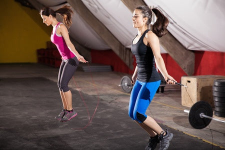 young women jumping rope
