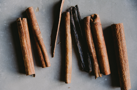cinnamon sticks on grey background