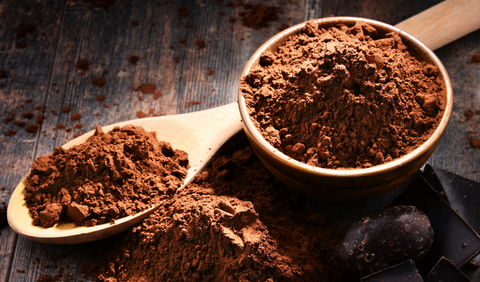 cocoa powder on wooden spoon