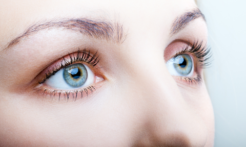 close up shot of woman with blue eyes