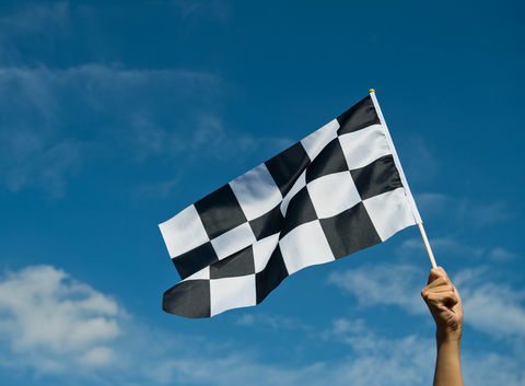 checkered race flag in hand