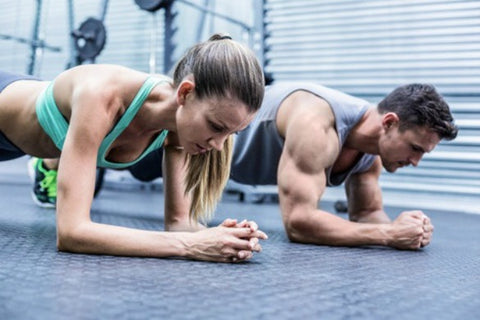 Man and woman excercising