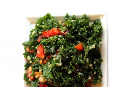 kale and quinoa salad on white plate