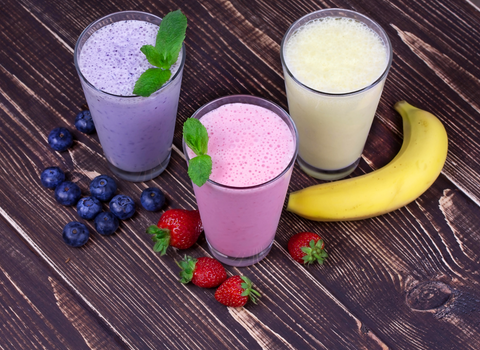 fruit smoothies on wooden table
