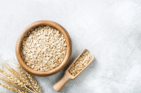 rolled oats on granite background