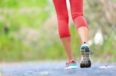 Woman with athletic legs on jog or run on trail