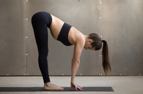 Standing Half forward bend exercise, head to knees