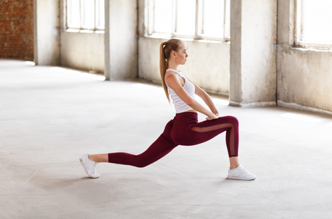 girl doing lunges working-out