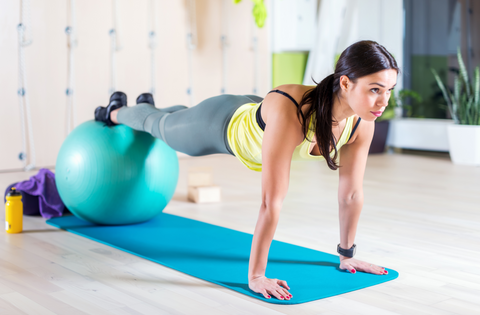 woman doing a plank on yoga ball