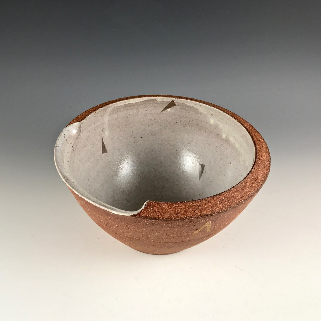 Adam Gruetzmacher pouring bowl