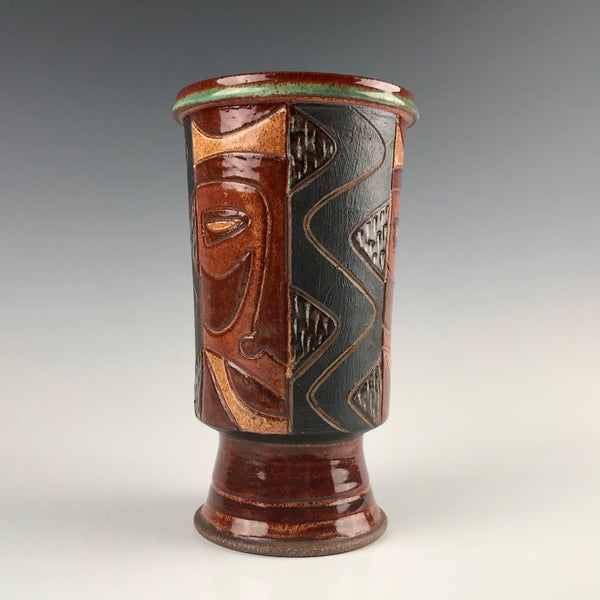 Peder Hegland vase with face design