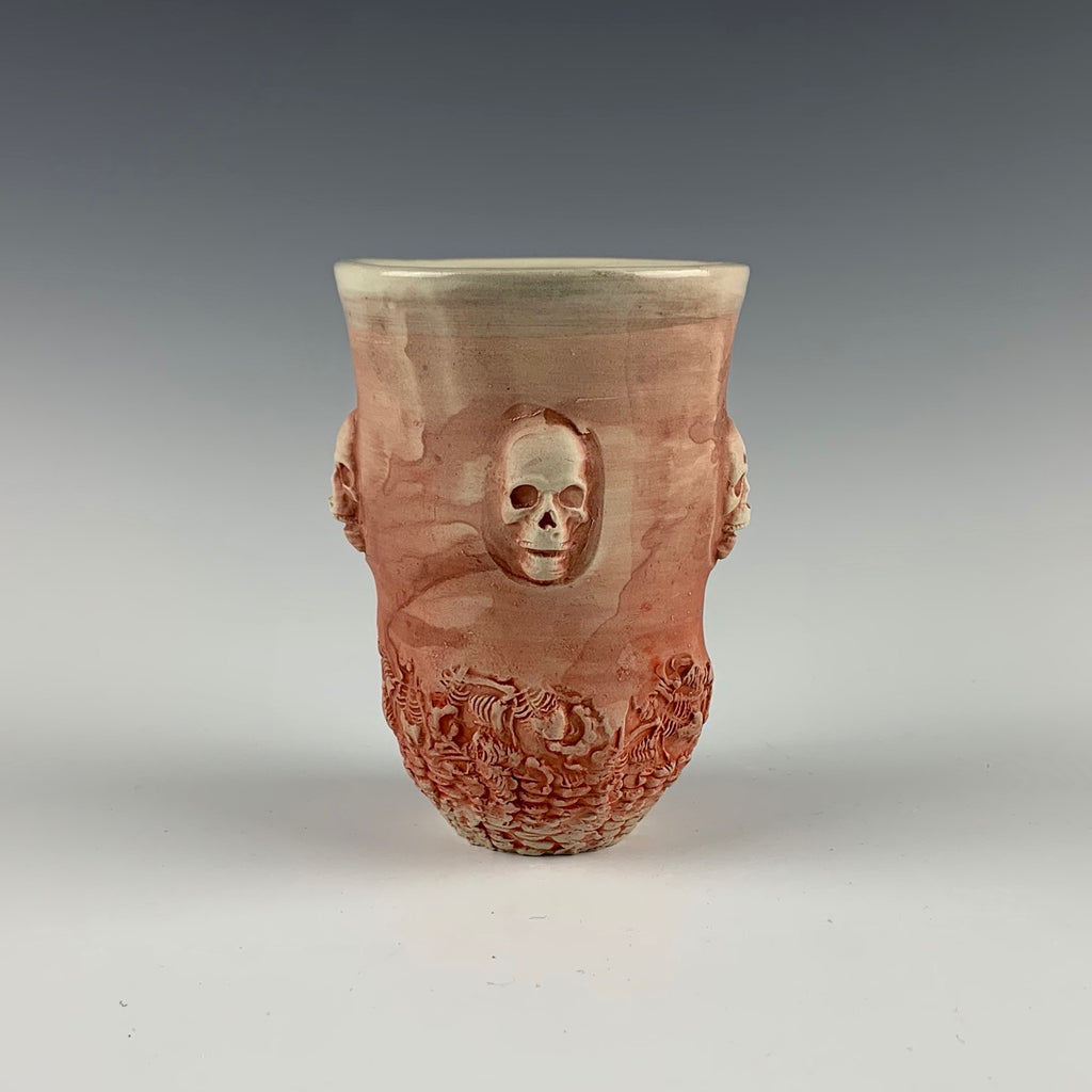 Ehren Tool cup, skulls in high relief