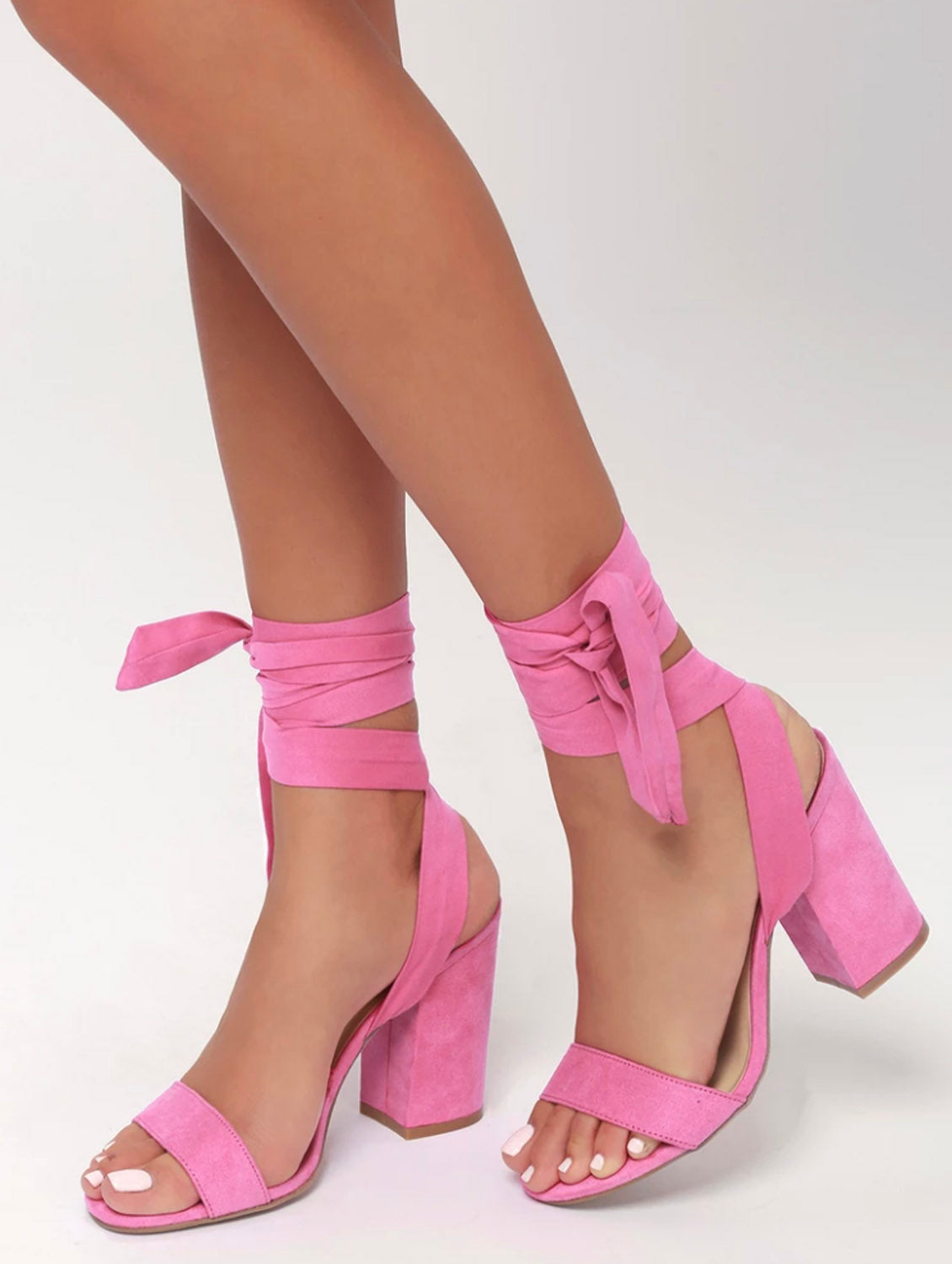 Closeup of strappy pink shoes
