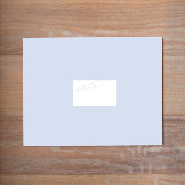 Elegant Script mailing label shown in Plum on Bluebell presentation envelope
