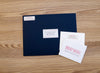 Simply Preppy personal note card next to Night presentation envelope