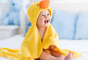 Picture of a happy baby in a duck blanket