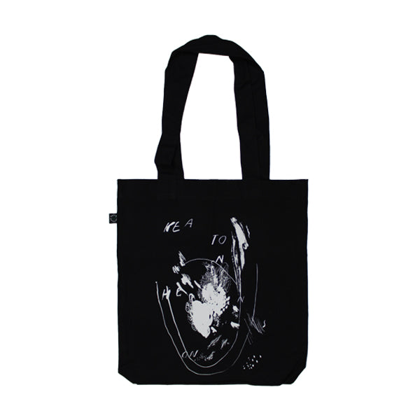 IN PIECES BLACK TOTE BAG