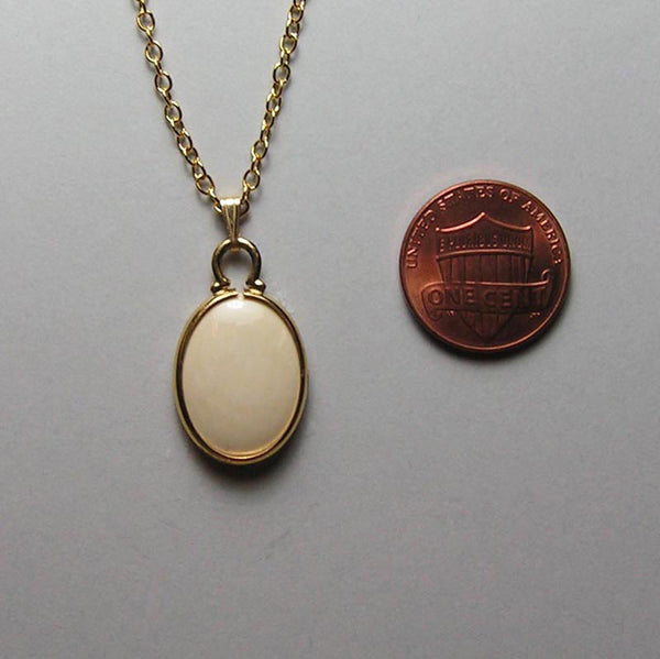 mammoth ivory and gold-filled pendant