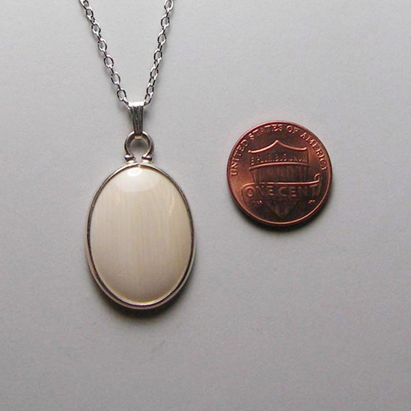 mammoth ivory and sterling pendant