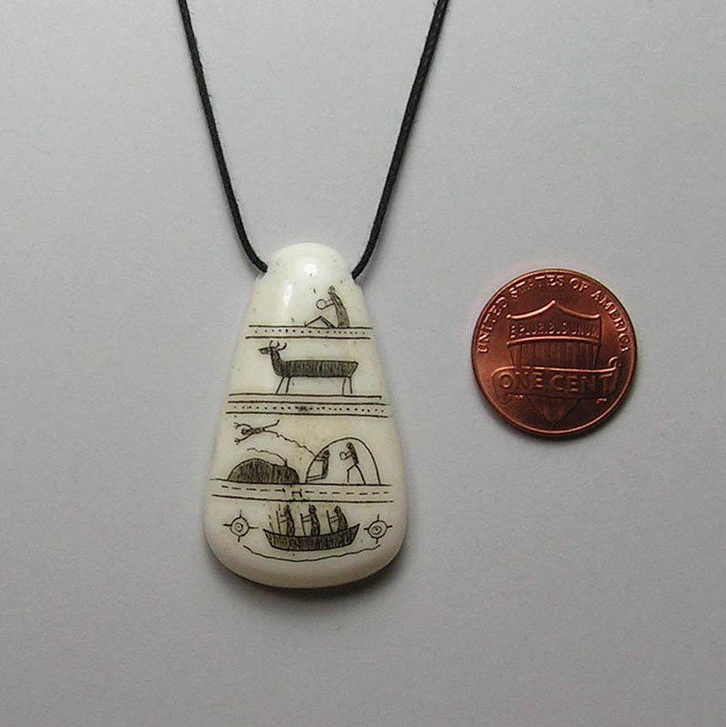 scrimshawed bone pendant