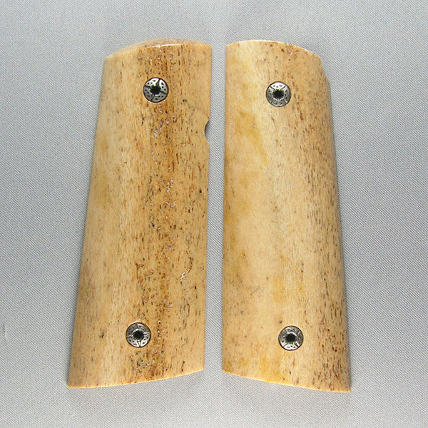 compact sea cow bone grips