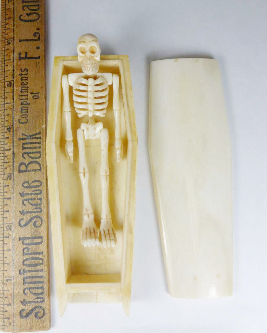 Bone Coffin with Carved Skelton