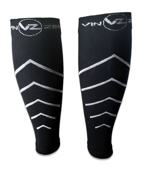 Black calf compression sleeves with white arrows pointing upwards There are 5 arrows on the sock and the Vin Zen logo at the top of the cuff. The arrows start out small at the bottom and then increase the higher up the sock they go