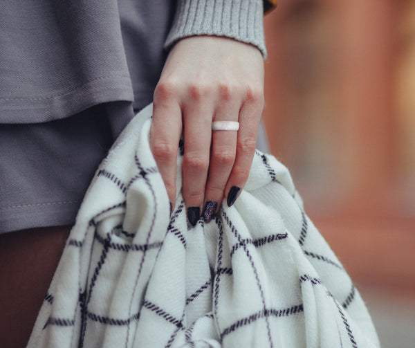 women carrying a blanket with pearl white silicone wedding ring thin flexible fit on left hand 5 6 7 8 9