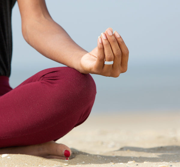 womens rubber ring on a lady doing yoga on the beach with red toe nails silicone ring