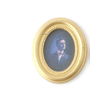Gentleman Photo In An Oval Frame