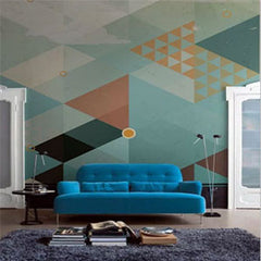 geometrical wall and blue sofa