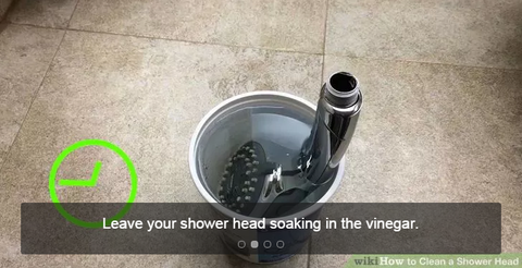 Leave the shower head in the vinegar for 1 hour