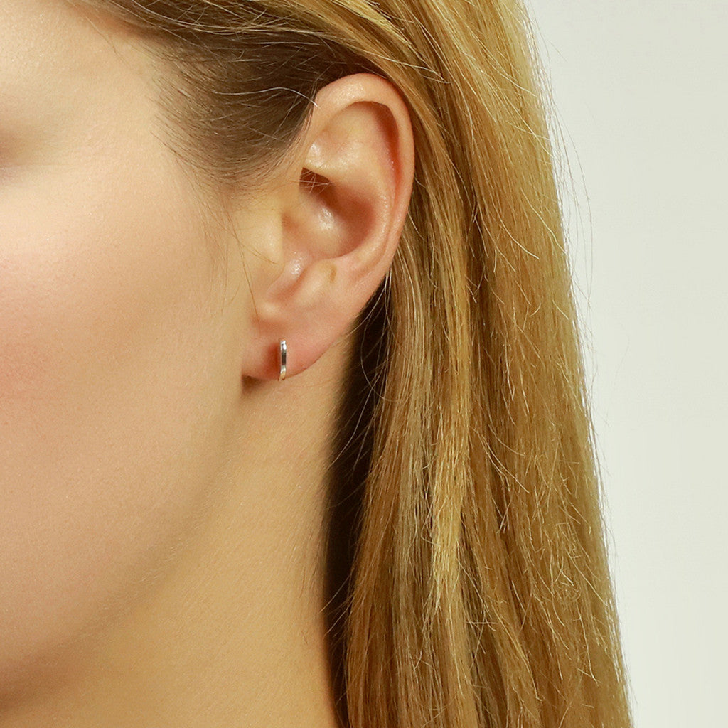 Single Ellipse Ear Studs in silver or yellow gold