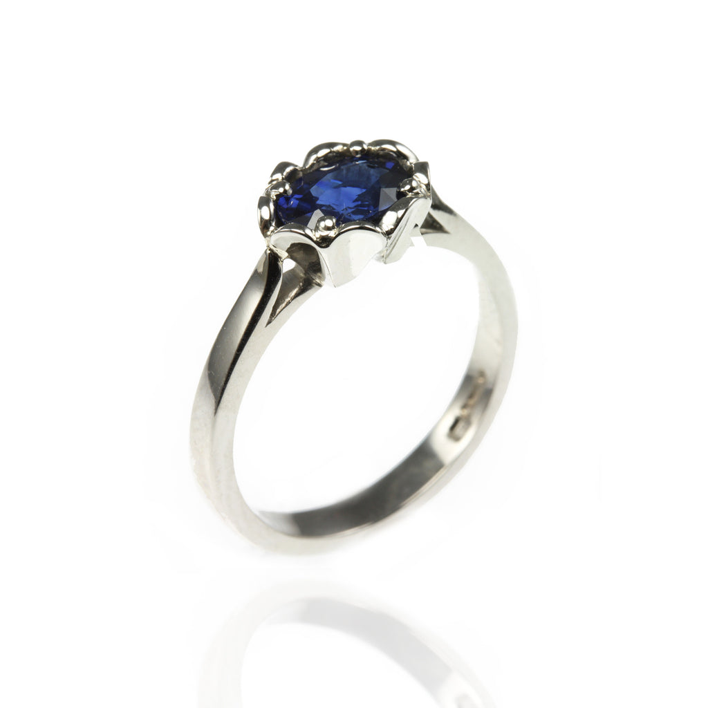 Platinum Sapphire Engagement Ring with Flower Setting