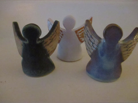 Angel shaped pottery votive holder by Ballymorris Pottery of Ireland in white for $20.