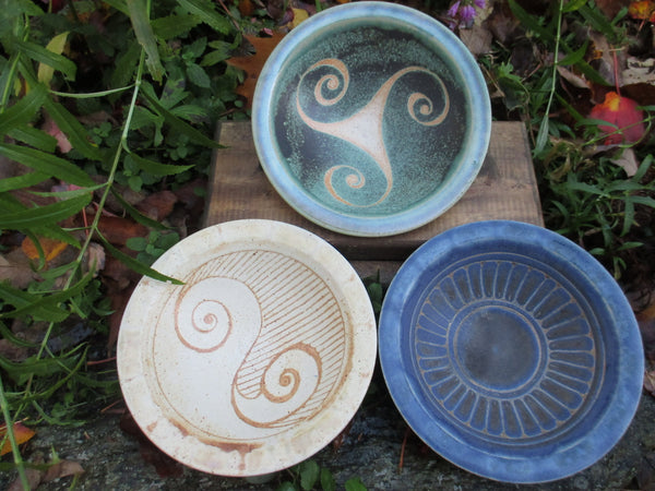 Stoneware bowls in cream, green or blue with Celtic designs in center by Ballymorris Pottery of Ireland