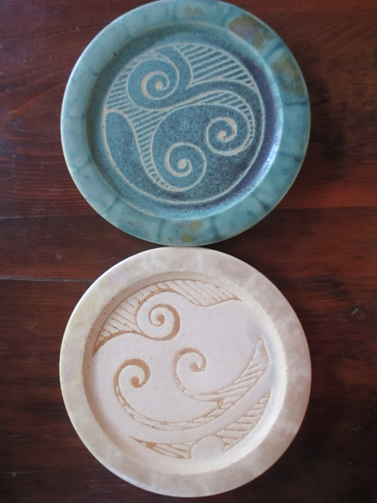 Small pottery plates in cream or green with celtic design in center made by ballymorris pottery of ireland.