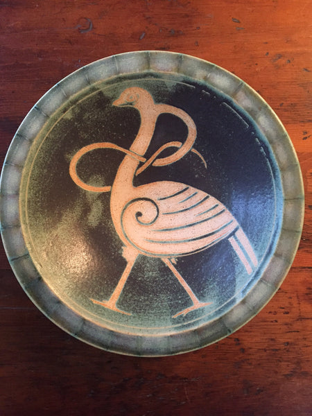 Stoneware green bowl with celtic design of swan in center by Ballymorris pottery of Ireland is