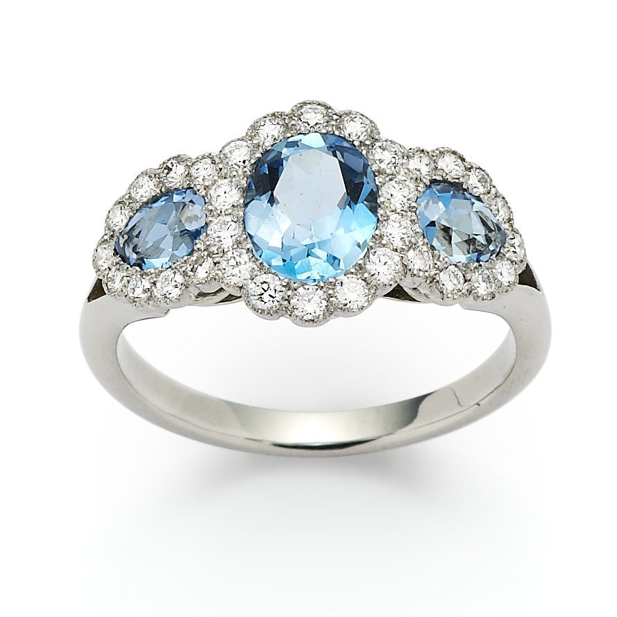 Aquamarine and diamond triple cluster engagement ring