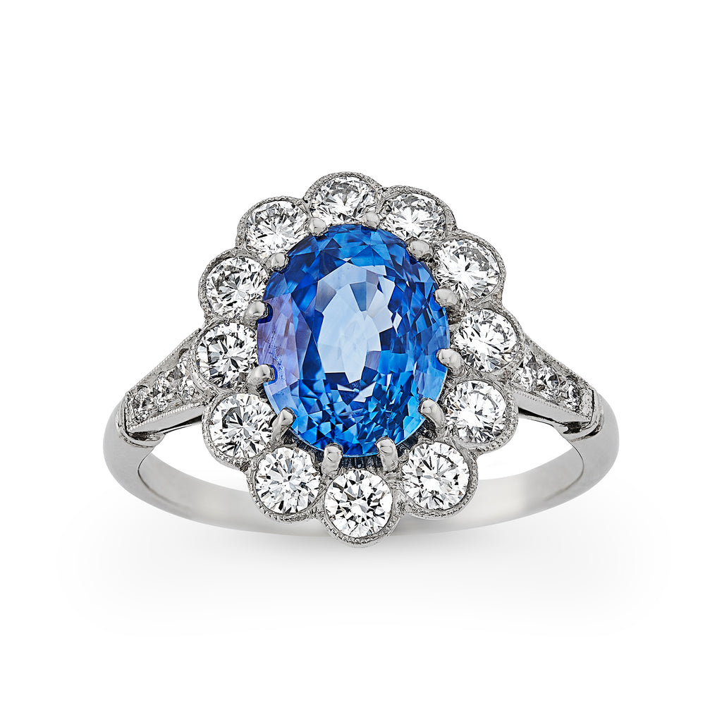 Oval Ceylon sapphire and diamond cluster engagement ring