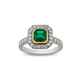 Octagon emerald and diamond cluster engagement ring