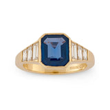 Emerald cut sapphire and baguette cut diamond ring