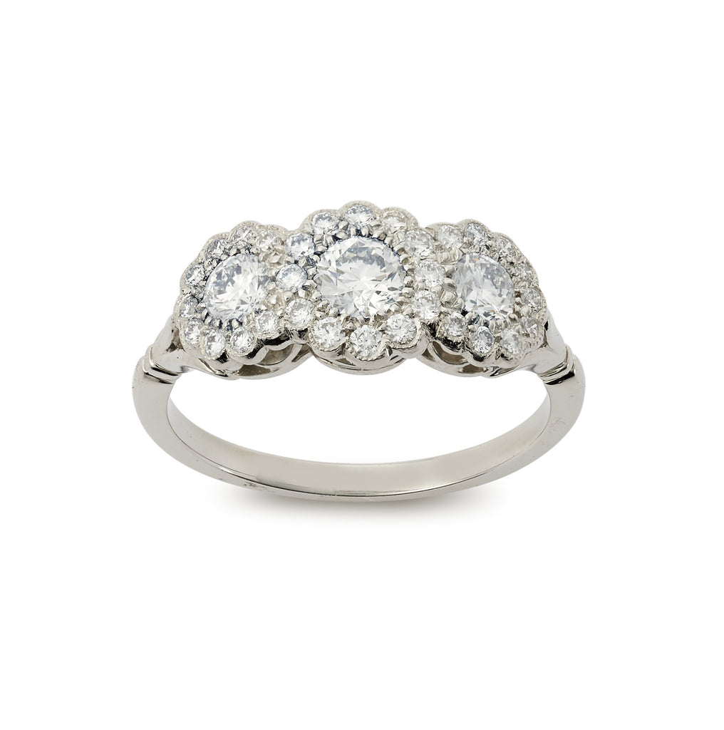 Brilliant cut diamond triple cluster ring