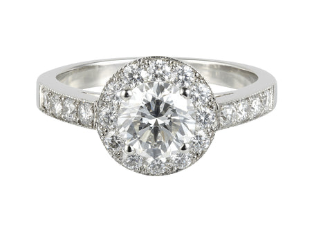 Oval and pear shaped diamond triple cluster engagement ring